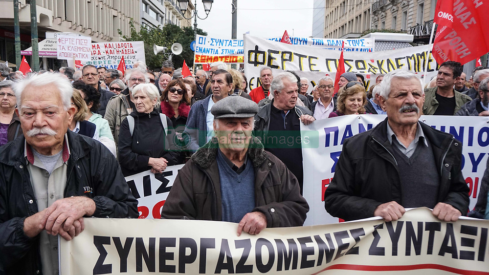 November 20, 2018 - Athens, Greece - Pensioners are seen holding banners and flags during the protest..Pensioners held a rally towards the Hellenic Parliament to demand for all the cuts as part of austerity measures. (Credit Image: © Ioannis Alexopoulos/SOPA Images via ZUMA Wire)