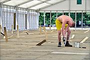 Nederland, Nijmegen,29-6-2015De voorbereidingen voor de nijmeegse vierdaagse zijn weer begonnen met de opbouw van het militair kamp op Heumensoord. De tenten worden geleverd door de Boer tentenbouw en geplaatst door vooral vakantiewerkers en seizoenskrachten. Kapotte planken worden vervangen. Er komen zo'n 5000 militairen uit verschillende landen te logeren. De 4-daagse vindt plaats in de derde week van juli. Ook militairen van de landmacht zijn al bezig met het aanleggen van de installaties. Foto: Flip Franssen/Hollandse Hoogte The International Four Day Marches Nijmegen (or Vierdaagse) is the largest marching event in the world. It is organized every year in Nijmegen mid-July as a means of promoting sport and exercise. Participants walk 30, 40 or 50 kilometers daily, and on completion, receive a royally approved medal, Vierdaagsekruisje. The participants are mostly civilians, but there are also a few thousand military participants. The maximum number of 45,000 registrations has been reached. More than a hundred countries have been represented in the Marches over the years. FOTO: FLIP FRANSSEN/ HOLLANDSE HOOGTE
