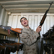 27 November 2004.FOB Kalsu...US Marine corporal Justin Dawson runs the arsenal at Forward Operating Base Kalsu in the recently dubbed 'Triangle of Death'..The US forces here claim much progress against insurgent forces including the seizure of weapons and amunition. One Corporal Dawson's duties is to catalouge the seized arms, recondition them and redistribute them to the newly trained Iraqi Defence Forces.