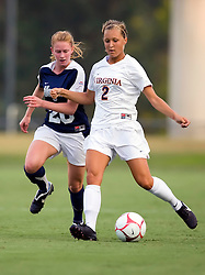 Virginia Cavaliers defender Sarah Senty (2) passes past Georgetown Hoyas defender Norah Swanson (20).  The #6 Virginia Cavaliers played the Georgetown Hoyas to a 2-2 draw in a NCAA Women's Soccer pre-season exhibition game held at Klockner Stadium on the Grounds of the University of Virginia in Charlottesville, VA on August 18, 2008.