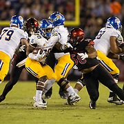 21 October 2016: The San Diego State Aztecs football team takes on the San Jose State Spartans Friday night at Qualcomm Stadium. San Diego State defensive lineman Alex Barrett (58) attempts to wrap up San Jose State running back Malik Roberson (20) in the second quarter. The Aztecs lead the Spartans 21-3 at halftime. www.sdsuaztecphotos.com