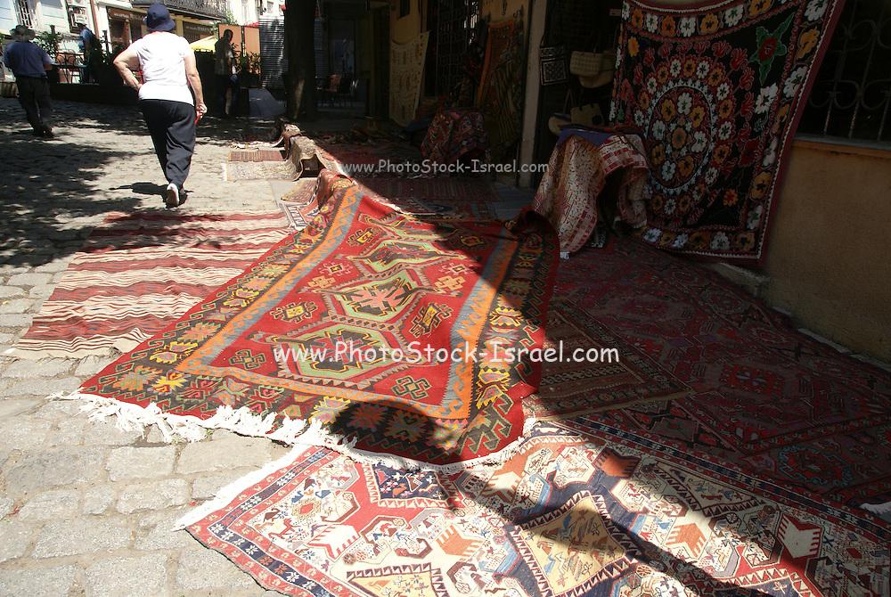 Georgia, Tbilisi, carpet vendor