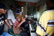 Rap Kreyol artist Yakuza and others work on mixing tracks at the Koze Kreyol studio in downtown Port-au-Prince, Haiti on July 17, 2008. The artist is a member of the group Bele Masif and was also featured with Barikad Crew. Three of the 11 members of Barikad Crew recently died in a tragic car crash.