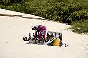 Itinerant salesman on the beach of Chave. Vendeur ambulant sur la plage de Chave.