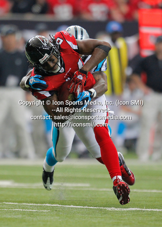 02 January 2011: Atlanta Falcons wide receiver Roddy White (84) makes the reception in the Atlanta Falcons 31-10 victory over the Carolina Panthers at the Georgia Dome in Atlanta Georgia.