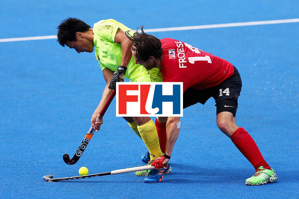 LONDON, ENGLAND - JUNE 24:  Adam Froese of Canada and Yang Ao of China battle for possession during the 5th-8th place match between Canada and China on day eight of the Hero Hockey World League Semi-Final at Lee Valley Hockey and Tennis Centre on June 24, 2017 in London, England.  (Photo by Steve Bardens/Getty Images)