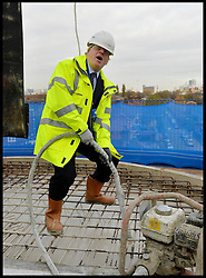 The London Mayor Boris Johnson- laying Concrete at the Greenwich Square building site before he makes a speech on Tackling London Housing needs. London, United Kingdom. Monday, 25th November 2013. Picture by Andrew Parsons / i-Images