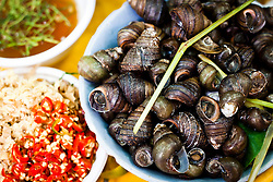 Boiled Snails being served at a food stall in Hanoi, Vietnam, Asia