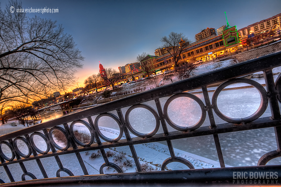 Kansas City Plaza Lights - close up view of decorative iron fence along pedestrian bridge over Brush Creek.