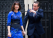 UNITED KINGDOM, London: 8 May 2015,  British Prime Minister David Cameron and his wife Samantha arrive back at 10 Downing street after paying a formal visit to the Queen at Buckingham Palace to ask her to form a Conservative government. London, England. Andrew Cowie / Story Picture Agency