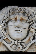 Giant head of Medusa, 2nd century AD, from the Temple of Apollo, 4th century BC, Didyma, Aydin, Turkey. This giant Medusa head at Didyma was formerly part of a frieze on the architrave, possibly sculpted by Aphrodisias. The Gorgons were 3 sisters (Medusa, Stheno and Euryale) with snakes for hair, who could turn people to stone. They are patrons of secrecy, protecting the mystery of the oracle, and their faces were here used as a charm against illness. Didyma was an ancient Greek sanctuary on the coast of Ionia near Miletus, consisting of a temple complex and the oracle of Apollo, or Didymaion, who was visited by pilgrims from across the Greek world. The earliest temple ruins found here date to the 8th century BC but Didyma's heyday lasted throughout the Hellenistic age. It was approached along a 17km Sacred Way from Miletus and is the largest sanctuary in Western Turkey. Picture by Manuel Cohen