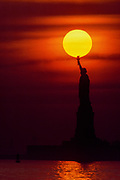 Statue of Liberty and Big Sun, New York City, New York, USA, December 1982