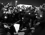 Protesters and Chicago police clash after then Republican presidential front-runner Donald Trump's rally was postponed Friday at the UIC Pavilion in Chicago, Ill., on March 11, 2016.