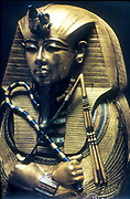 Tutankhamun (Tutankamen), king of Egypt, reigned 1361-1352 BC. 18th Dynasty.  Representation from the coffin containing his mummy, showing him holding the flail and the crook, the symbols of kingship.  Egyptian Museum, Cairo.