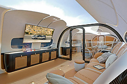 "June 6, 2017 - inconnu - The sky is the limit for passengers on a new executive private jet – which features a live view of the outside inside the cabin.The Infinito cabin on the new Airbus ACJ319Neo has a ceiling, which can bring a live view of the sky above the aircraft into the cabin – or display other images. This creates an even greater feeling of airiness and space.It can all be done at the touch of a button and make passengers feel there are no walls between them and the sky outside.It was created for Airbus by Italian supercar company Pagani Automomobili.The design uses s state-of-the-art composite materials never seen before in an aircraft, such as CarboTitanium, a mixture of super-strong carbon fibre and titanium.Pagani's design team created the initial Infinito design, including its look and feel, while Airbus Corporate Jets' designers contributed their experience in aircraft design and compatibility.A spokesman said curves inspired by nature form a pathway through the cabin, as well as featuring in the shell-shaped valances and walls between zones .This includes one between lounge and conference areas, which switches from opaque to transparent at the touch of a button.Décor is reminiscent of that gracing Pagani cars, with natural soft-leather carpets and a wooden floor contrasting with man-made carbon fibre in furniture and wall-frames.The spokesman said this echoes the combination of art and science ""originally espoused by Leonardo da Vinci.""Sculpted metal features, mirroring those found in Pagani cars, feature in light-fittings and other details, while LED lights enable different mood-lighting ambiances.Pagani founder and chief designer Horacio Pagani said:"" Applying our Reinassance touch into the wider spaces of Airbus corporate jet cabins is the beginning of an exciting new venture for us.""The aircraft is part of the Airbus' ACJ320 family which already has the widest and tallest business j"