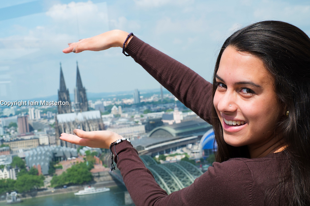 Tourist looking at famous cathedral and skyline of Cologne  in Germany