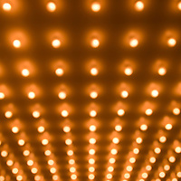 Picture of theater lights in rows out of focus. Image is vertical, high resolution, and is available as a stock photo, poster or print.