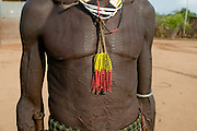 Very skinny with scarfs fillled, Omovalley,Ethiopia,Africa