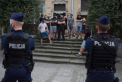 """© Licensed to London News Pictures 20/08/2020 Gdańsk,Poland. A group of LGBT opponents. I am LGBT - is a motto for the rally in Gdańsk, northen Poland 'in the name of solidarity with people who are humiliated, insulted and deprived dignity' inspired by a member of the European Parliament Magdalena Adamowicz's post on Twitter. <br /> Gay rights are increasingly under threat in Poland endorsed by the government. <br /> Polish President Andrzej Duda has said the LGBT movement is """"more destructive"""" than communism. The Polish government has frequently used inflammatory language against the LGBT community.<br /> Poland does not currently recognise same-sex unions - whether those are marriages or civil unions. Same-sex couples are also legally banned from adopting children. Photo credit: Marcin Nowak/LNP"""