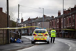 © Licensed to London News Pictures . 29/12/2018 . Wigan , UK . Police at the scene where they have taped off a stretch of Bickershaw Lane in Abram . GMP report they have arrested two people on suspicion of attempted murder and for conspiracy to commit attempted murder , respectively , after a 21-year-old man sustained life-threatening injuries yesterday evening (Friday 28th December 2018) . Photo credit : Joel Goodman/LNP