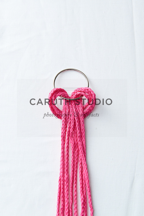 Making lark's head knot with macrame cord on metal ring