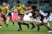 Reed Prinsep looks to get clear of the defence during the Super Rugby match, Brumbies V Hurricanes, GIO Stadium, Canberra, Australia, 30th June 2018.Copyright photo: David Neilson / www.photosport.nz