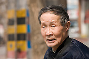Elderly man in the park by the City Wall, Xian, China