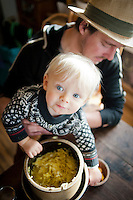 Jess Piskor helps his one year old son Rudy try some home made curry sauerkraut.