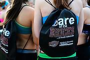 Kelsey Glaser, right, and Maria Stadelman, left, freshman on the Ohio University Women's Club Soccer team, wear free Bare on the Bricks bags given out in-front of Baker University Center Saturday, February 23, 2013. After donating clothing, students ran from Baker to the Pigskin Bar and Grille to support local shelters, families and organizations in need of clothing.