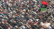 People pray during Friday prayers in the main square in Benghazi, Libya during the 2011 Libyan Civil War.