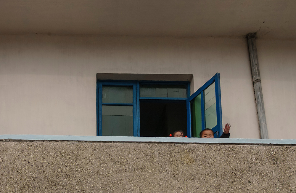 North Korea:<br /> North Hwanghae Province<br /> <br /> Toddlers wave from a nursery at Yonsan <br /> <br /> <br /> &copy;Jeremy Horner<br /> 15 Mar 2004