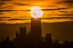 © Licensed to London News Pictures. 06/02/2019. Ely UK. The sun rises this morning over the west tower of Ely Cathedral, The cathedral dates back to 1083 & dominates the surrounding landscape.  Photo credit: Andrew McCaren/LNP