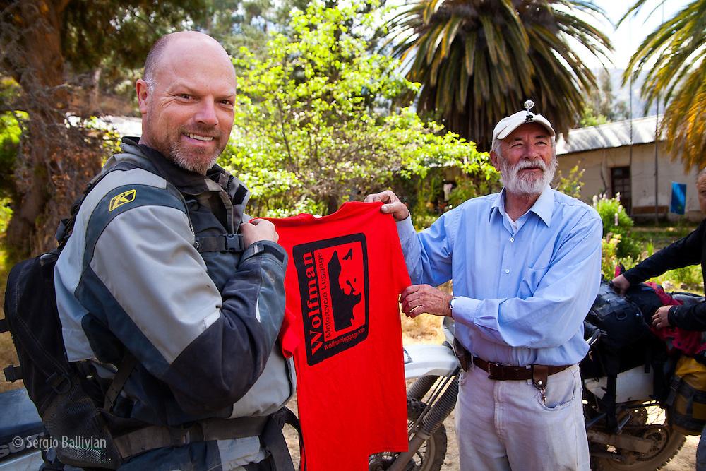 Eric Hougen presents Hans Hesse with a Wolfman t-shirt at  Hacienda Teneria in the Cordillera Quimsa Cruz, Bolivia.
