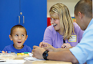 "Presidential Park Elementary School kindergarten student Noah Ferstand makes a face after playing with colored shapes as his teacher Melissa Verbert and his father Adam Ferstand look on during ""Join Your Kids at Kindergarten Day"" on Monday, Sept. 9, 2013. Kindergarten students will have their first full day of school of Tuesday, Sept. 10, 2013. The rest of Middletown's students had a full day on Monday."