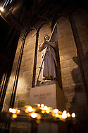 A statue of Saint Joan of Arc stands inside Paris' Cathedral of Notre Dame.