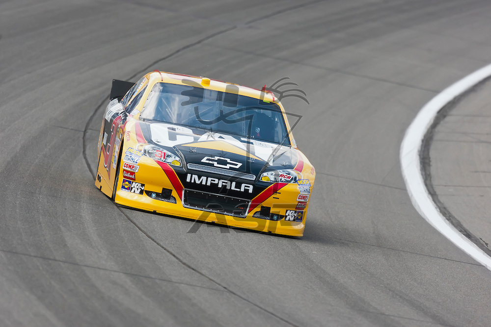 KANSAS CITY, KS - APR 20, 2012:  Jeff Burton (31) brings his car through the turns during a practice session for the STP 400 at the Kansas Speedway in Kansas City, KS.