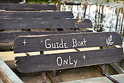 Guide boat notice on a boat in the blackwater bald cypress and tupelo swamp during spring at Cypress Garden April 9, 2014 in Moncks Corner, South Carolina.