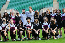 Prince Harry poses with players during a Rugby Football Union schools coaching session at Twickenham Stadium in London, United Kingdom, Thursday, 17th October 2013. Picture by Stephen Lock / i-Images