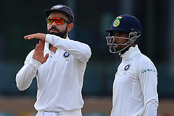 August 4, 2017 - Colombo, Sri Lanka - Indian cricket captain Virat Kohli (L) challenges a decision made by the on field umpire by taking a ' review ' during the 2nd Day's play in the 2nd Test match between Sri Lanka and India at the SSC international cricket stadium at the capital city of Colombo, Sri Lanka on Friday 04 August 2017. (Credit Image: © Tharaka Basnayaka/NurPhoto via ZUMA Press)