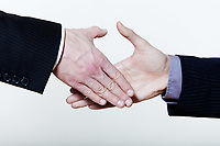 two men handshake close-up on studio  isolated white background