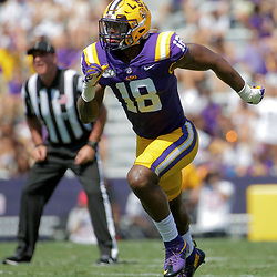 Oct 5, 2019; Baton Rouge, LA, USA; LSU Tigers linebacker K'Lavon Chaisson (18) rushes the quarterback against the Utah State Aggies during the first half at Tiger Stadium. Mandatory Credit: Derick E. Hingle-USA TODAY Sports