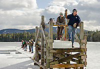 Perfect ice harvesting weather on Squaw Cove for the annual Rockywold-Deephaven Camp as Dave Lacasse and the crew stands at the ready for the next truck coming in for loading.  (Karen Bobotas/for the Laconia Daily Sun)