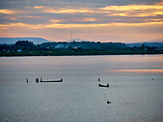 Laos, Vientiane. Mekong sunset with view towards the Thai side.