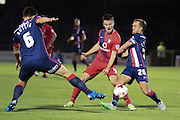 Doncaster Rovers midfielder James Coppinger tackles York City midfielder James Barrett during the Johnstone's Paint Trophy match between York City and Doncaster Rovers at Bootham Crescent, York, England on 6 October 2015. Photo by Simon Davies.