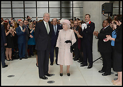 HM The Queen is escorted around the Lloyds of London building in the City of London, by The Chairman of Lloyds of London John Nelson, Thursday, 27th March 2014. Picture by Andrew Parsons / i-Images