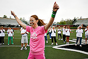 Maryann Gunderson celebrates after completing a pass during the Mom's Weekend football clinic hosted by the OU football team May 5, 2007 at Peden Stadium.