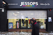 Members of staff close the shutters on their Jessops shop on Upper Street, Islington, central London for the final time.  Jessops is a British photographic retailing company, which was founded in 1935, but the business entered administration in January 2013 and all retail stores ceased trading on 11 January 2013.