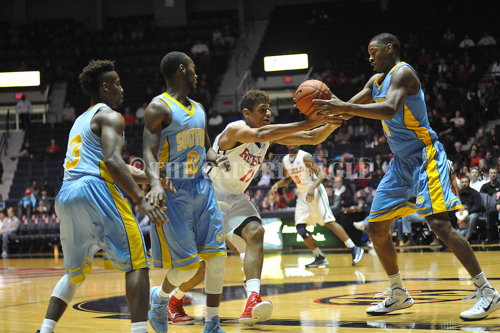 "Ole Miss' forward Sebastian Saiz (11) turns the ball over to southern University Jaguars forward Keith Davis (4) at the C.M. ""Tad"" Smith Coliseum in Oxford, Miss. on Thursday, November 20, 2014. (AP Photo/Oxford Eagle, Bruce Newman)"