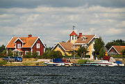 Houses painted yellow or Falu Red are symbolic of Swedish life. Add in sunshine, water, and fast boats and you having the makings of a typical summer's day in southern Sweden.