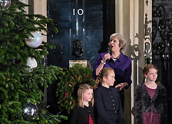 © Licensed to London News Pictures. 08/12/2016. London, UK. Prime Minister Theresa May switches on the Downing Street Christmas tree lights. The Prime Minister was joined by children nominated by UK charities and a local school choir. Photo credit: Rob Pinney/LNP